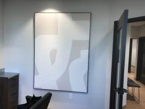 abstract artwork on wall of salon suite rental at Orem Indie Studio Suites