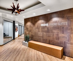 entryway to Orem Indie Studio Suites with logo on wall