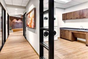 break room with washer and dryer in Orem Indie Studio Suites