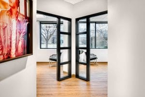 hallway with wall artwork and interior of salon suite rentals in Orem Indie Studio Suites
