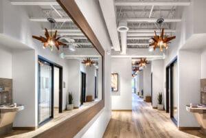 hallway view of Bountiful studio salon suites with mirror